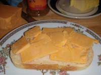 Placing the cheese on the bread Picture